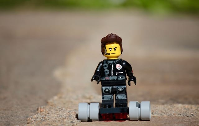 A lego riding a hoverboard