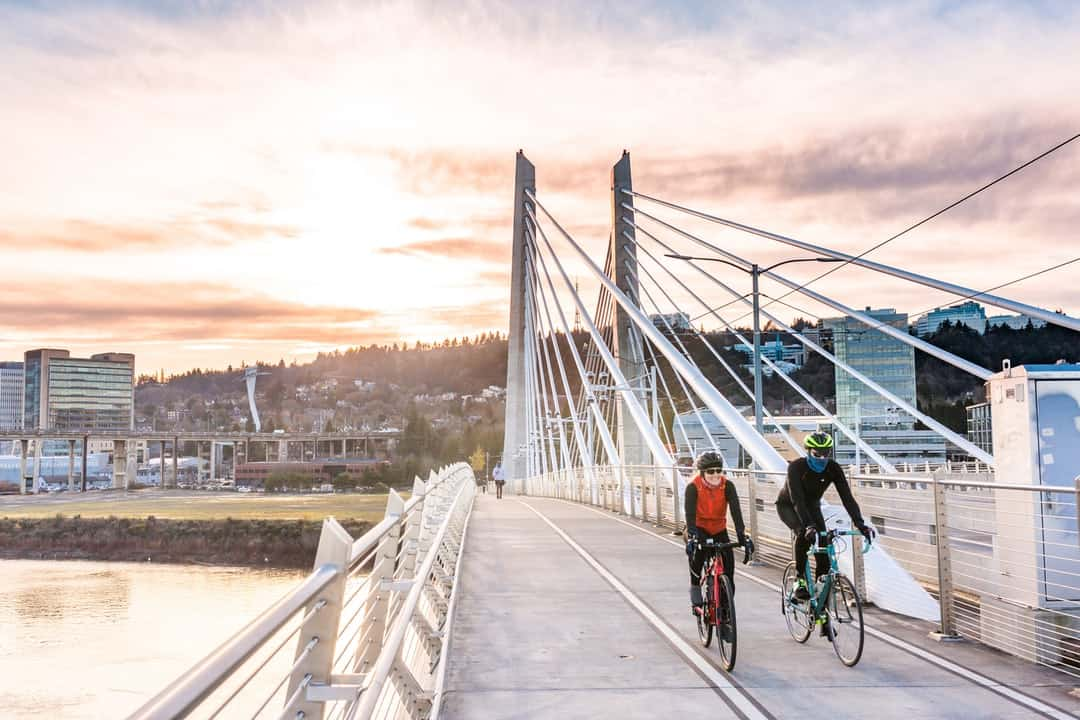 A person riding a bicycle on a bridge