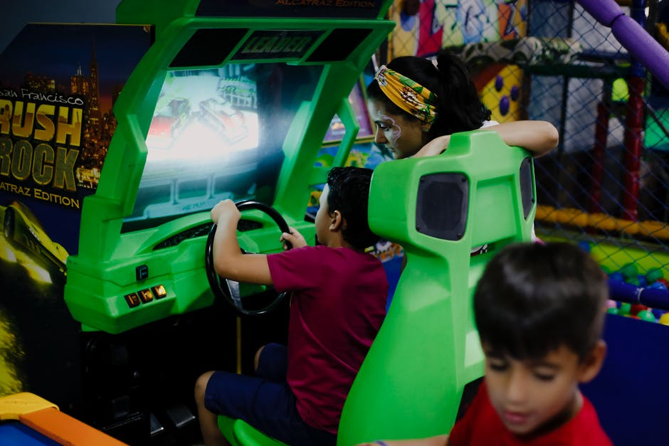 A young boy playing with a video game